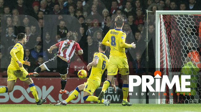 Sam Saunders of Brentford scores his goal during the Sky Bet Championship match between Brentford and Leeds United at Griffin Park, London, England on 26 January 2016. Photo by Andy Rowland / PRiME Media Images.