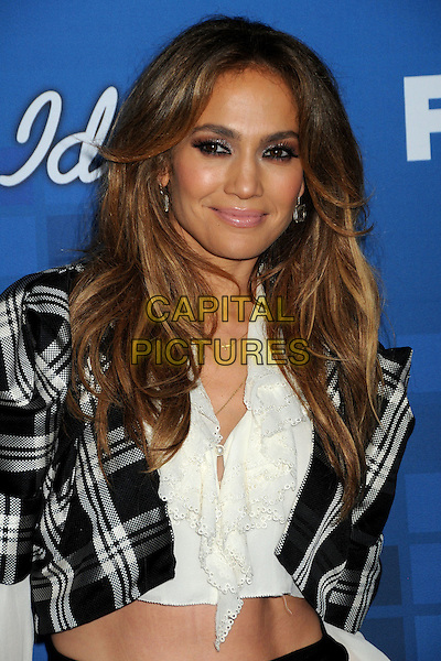 "JENNIFER LOPEZ.Fox's ""American Idol"" Season 10 Finalist Party held at The Grove, Los Angeles, California, USA..March 3rd, 2011.half length black white plaid tartan shirt jacket make-up beauty knotted belly stomach midriff .CAP/ADM/BP.©Byron Purvis/AdMedia/Capital Pictures."