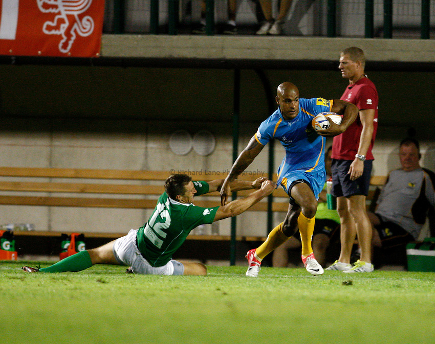 Photo: Richard Lane/Richard Lane Photography. Benetton Rugby Treviso v London Wasps. Pre season friendly. 10/08/2012. Wasps' Tom Varndell breaks from Treviso's Alberto Sgarbi.