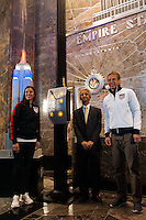 U.S. women national team midfielder Carli Lloyd, U.S. Soccer president Sunil Gulati, and U.S. men's head coach Jurgen Klinsmann pose for a photo after fliping the switch to light the Empire State Building in the Red White and Blue colors of the US Soccer Federation during the centennial celebration of U. S. Soccer in New York, NY, on April 05, 2013.
