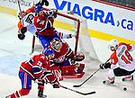 7 December 2009: Philadelphia Flyers' left wing forward Scott Hartnell is checked into the net during the first period by Montreal Canadiens left wing forward Travis Moen (32) at the Bell Centre in Montreal, Quebec, Canada. The Canadiens defeated the Flyers 3-1. Mandatory Credit: Ed Wolfstein Photo