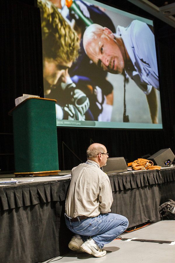 At the 2012 Spring JEA Convention in Seattle, Mark Murray assists with the Photography Critique at the Seattle, Washington State Convention Center.