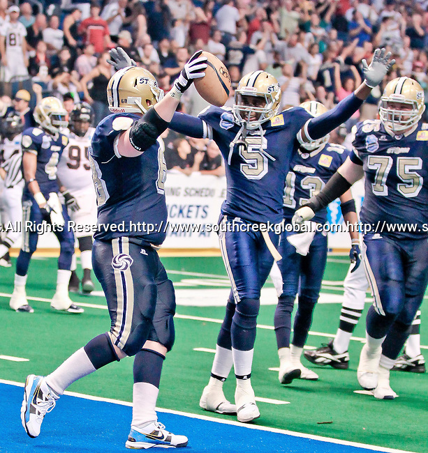 Aug 14, 2010: Tampa Bay Storm center Robert Powell (#68) celebrates his touchdown with teammate Tyrone Timmons (#5). The Storm defeated the Predators 63-62 to win the division title at the St. Petersburg Times Forum in Tampa, Florida. (Mandatory Credit:  Margaret Bowles)