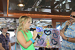 General Hospital Kristen Alderson and Walt Willey auction of Kristen's painting with Kristian bought it back - money going to charity. at SoapFest's Celebrity Weekend - Cruisin' and Schmoozin' on the Marco Island Princess - mix and mingle and watching dolphins - autographs, photos, live auction raising money for kids on November 11, 2012 Marco Island, Florida. (Photo by Sue Coflin/Max Photos)