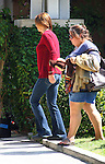 September 26th 2012 <br /> <br /> Kate Walsh filming the tv show Private Practice in Los Angeles.  Wearing a red sweater smiling &amp; a blue jacket pushing a baby on the swing set in a park with co star Benjamin Bratt<br /> <br /> AbilityFilms@yahoo.com<br /> 805 427 3519 <br /> www.AbilityFilms.com