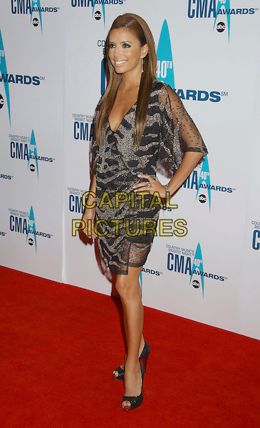 EVA LONGORIA.Arrivals - 40th Annual CMA Awards held at Gaylord Entertainment Center, Nashville, Tennessee, USA, .06 November 2006..full length hand on hip black and silver beaded dress open toe peeptoe platform shoes sparkly glittery.Ref: ADM/LF.www.capitalpictures.com.sales@capitalpictures.com.©Laura Farr/AdMedia/Capital Pictures. *** Local Caption *** .