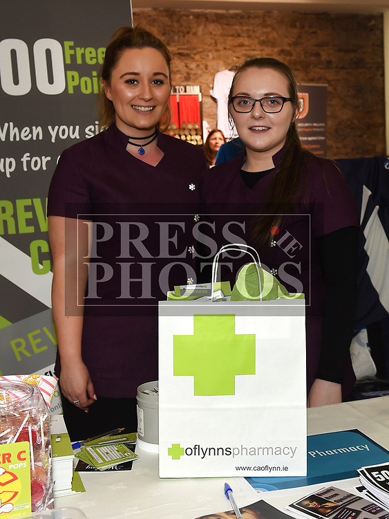 Amy Farrelly and Fern McCarron from O'Flynn's Pharmacy at the Bank of Ireland Expo held in the old church Ardee. Photo:Colin Bell/pressphotos.ie