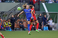 Portland, Oregon - Sunday May 29, 2016: Seattle Reign FC defender Lauren Barnes (3) goes up for a header with Portland Thorns FC forward Nadia Nadim (9). The Portland Thorns play the Seattle Reign during a regular season NWSL match at Providence Park.