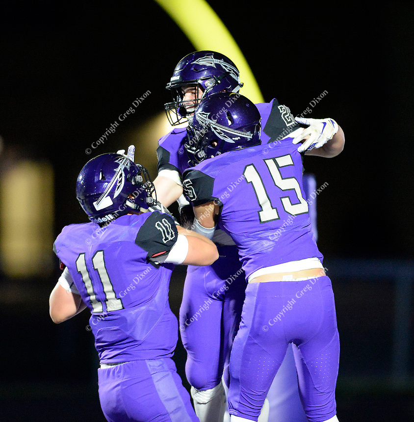Waunakee's Josh Block (left) and Caden Lewis (right) celebrate Will Ross's touchdown, as Reedsburg takes on Waunakee in Wisconsin Badger North Conference high school football at Waunakee High School on Friday, 9/28/18