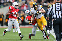 Iowa Hawkeyes tightened George Kittle (46) is tackled by Ohio State Buckeyes cornerback Bradley Roby (1) during Saturday's game in Columbus, Ohio on Saturday, Oct. 19, 2013. (Jabin Botsford / The Columbus Dispatch)