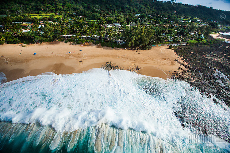 Big waves rush towards the beach on Oahu's North Shore.