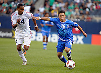 El Salvador's Jamie Alas dribbles away from Cuba's Alianni Urgelles.  El Salvador defeated Cuba 6-1 at the 2011 CONCACAF Gold Cup at Soldier Field in Chicago, IL on June 12, 2011.