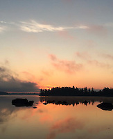 Courtesy photo/KRISTEN LEWIS<br /> Lake is a reflecting pool at dawn during Lewis' journey.