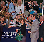 Pierce Brosnan arrives for the screening of the premiere of 'The November Man' during the 40th Deauville American Film Festival on September 5, 2014 in Deauville,