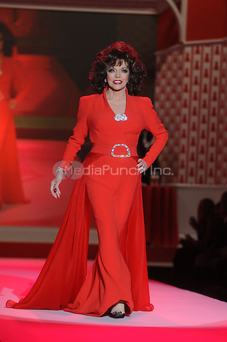 Joan Collins walks the runway at the Heart Truth Fall 2010 Fashion Show during Mercedes-Benz Fashion Week at The Tent at Bryant Park in New York City. February 11, 2010. Credit: Dennis Van Tine/MediaPunch