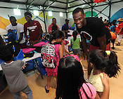 Handing out backpacks at Boys and Girls Club