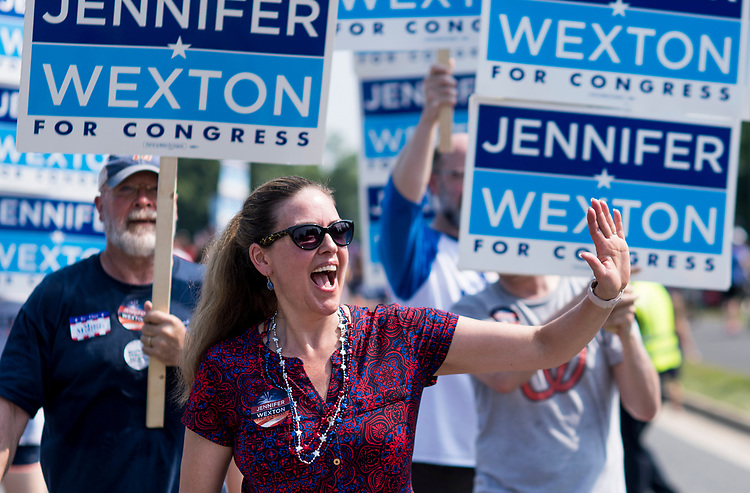 UNITED STATES - JULY 4: Jennifer Wexton waves to the crowd in Leesburg, Va., as she participates in the Leesburg Independence Day Parade on July 4, 2018. Wexton is challenging incumbent Republican Barbara Comstock for Virginia's 10th Congressional district seat. (Photo By Bill Clark/CQ Roll Call)