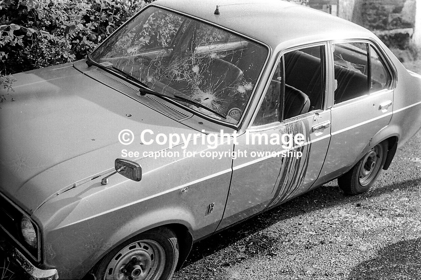 The unmarked police car in which three police officers died whilst on routine patrol near Ardboe, Co Tyrone, on 2nd June 1977. The ambush was carried out by three members of the Provisional IRA each armed with an Armalite rifle. After the police vehicle crashed the gunmen approached firing a further 20 shots into the Ford Escord. Ardboe is on the western shore of Lough Neagh. In 1979 a 22 year old Coalisland man was jailed for life for the three murders. The policemen who died were: Samuel Derek Davison, Kenneth Norman Lynch and Hugh Martin. 197706020206a<br />