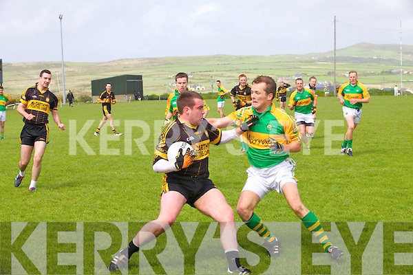 Stephen O'Sullivan for Skellig Rangers defends as he squares up to Currow's advancing Mike McCarthy.