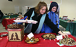 WATERTOWN CT. 30 December 2017-123017SV01-Stacy LaPerriere and her daughter Laura LaPerriere of Watertown choose cookies to take home during the annual holiday cookie party at New Hope Anglican Church in Watertown Saturday.<br /> Steven Valenti Republican-American