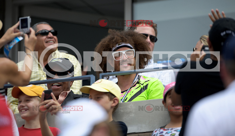 September 2, 2012: Stefan 'Redfoo' Gordy (R) of LMFAO with his father Berry Gordy, Jr. watch the action during Day 7 of the 2012 U.S. Open Tennis Championships at the USTA Billie Jean King National Tennis Center in Flushing, Queens, New York, USA. Credit: mpi105/MediaPunch Inc. /NortePhoto.com<br />