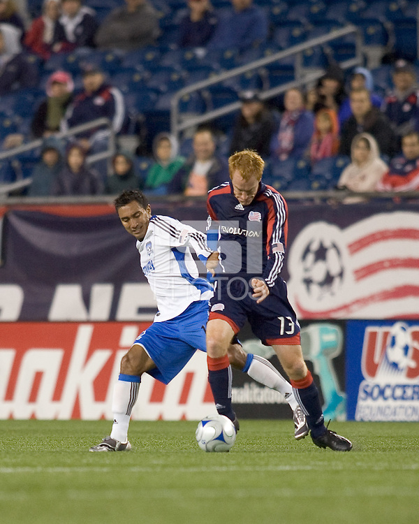 San Jose Earthquakes forward/midfielder Arturo Alvarez (10) grabs at a dribbling New England Revolution midfielder/defender Jeff Larentowicz (13). The New England Revolution defeated San Jose Earthquakes, 2-1, at Gillette Stadium on August 29, 2009.