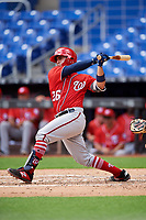 Washington Nationals catcher Tres Barrera (26) follows through on a swing during a Florida Instructional League game against the Miami Marlins on September 26, 2018 at the Marlins Park in Miami, Florida.  (Mike Janes/Four Seam Images)