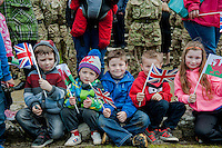 Wednesday 26 March 2014<br /> Pictured: Children with flags<br /> Re: 236 Signal Squadron ( part of 14 Signal regiment who are based at Cawdor Barracks in Brawdy Parade through the streets of  St.Davids Pembrokeshire led by Haverfordwest Air Training Corps Band and are then Presented with medals