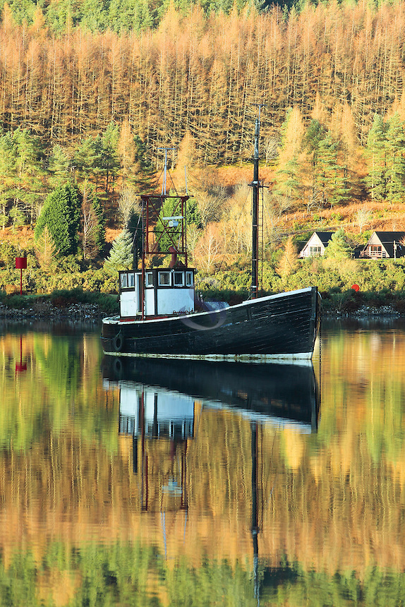Boat at Loch Lochy in autumn at Laggan Locks on the Caledonian Canal, Highland<br /> <br /> Copyright www.scottishhorizons.co.uk/Keith Fergus 2011 All Rights Reserved