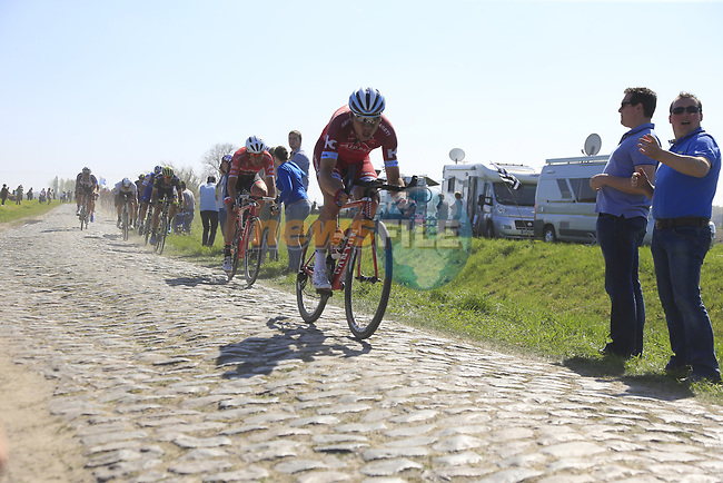 The peloton including Tony Martin (GER) Team Katusha Alpecin on pave sector 17 Hornaing a Windignies during the 115th edition of the Paris-Roubaix 2017 race running 257km Compiegne to Roubaix, France. 9th April 2017.<br /> Picture: Eoin Clarke | Cyclefile<br /> <br /> <br /> All photos usage must carry mandatory copyright credit (&copy; Cyclefile | Eoin Clarke)