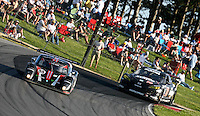21 June 2009: A pair of race cars races ppast fans during the EMCO Gears Road Racing Classic at Mid-Ohio Spotts Car Course ini Lexington, OH.