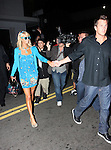 .6-8-09.Paris Hilton wearing a blue dress and sun glasses signing autographs while leaving Beso Restaurant in Los Angeles with boyfriend doug Reinhardt..AbilityFilms@yahoo.com.805-427-3519.