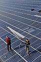 03/03/11 - ENNEZAT - PUY DE DOME - FRANCE - Pose de panneaux photovoltaiques sur une exploitation agricole. Installing solar panels on a French farm - Photo Jerome CHABANNE