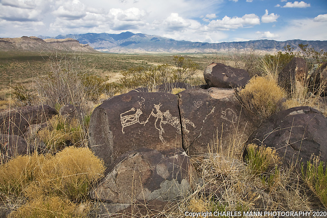 Mysterious petroglyphs adorn stones looking out at the rugged Sacramento Mountains inThree Rvers State Park near Tularosa in  southern New Mexico