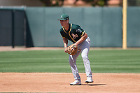 Oakland Athletics shortstop Kevin Merrell (4) during a Minor League Spring Training game against the San Francisco Giants at Lew Wolff Training Complex on March 26, 2018 in Mesa, Arizona. (Zachary Lucy/Four Seam Images)
