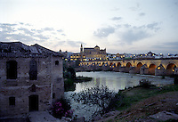 Sunset in Cordoba Spain, looking out over the Guadalquivir River, the Roman Bridge and The Cathedral of Cordoba formerly the Mezquita Mosque
