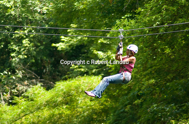 Mrs Lorna Goldman riding the zip lines at Chukka near Montego Bay.