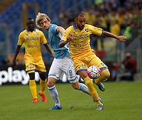 Calcio, Serie A: Lazio vs Frosinone. Roma, stadio Olimpico, 4 ottobre 2015.<br /> Frosinone's Danilo Soddimo, right, is challenged by Lazio's Dusan Basta during the Italian Serie A football match between Lazio and Frosinone at Rome's Olympic stadium, 4 October 2015.<br /> UPDATE IMAGES PRESS/Isabella Bonotto
