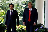 United States President Donald J. Trump and Prime Minister of Japan Shinzo Abe walk out from the Oval Office before their joint news conference in the Rose Garden of the White House on June 7, 2018 in Washington, DC. <br /> Credit: Yuri Gripas / Pool via CNP