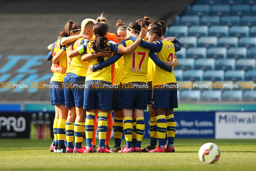 Arsenal Ladies huddle ahead of kick-off - Millwall Lionesses vs Arsenal Ladies - FA Womens Challenge Cup 5th Round Football at the New Den, Bermondsey, London - 22/03/15 - MANDATORY CREDIT: TGSPHOTO - Self billing applies where appropriate - contact@tgsphoto.co.uk - NO UNPAID USE