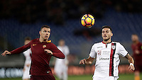 Calcio, Serie A: Roma vs Cagliari, Roma, stadio Olimpico, 22 gennaio 2017.<br /> Roma's Edin Dzeko, left, in action with Cagliari's Luca Ceppitelli, right, during the Italian Serie A football match between Roma and Cagliari at Rome's Olympic stadium, 22 January 2017. <br /> UPDATE IMAGES PRESS/Isabella Bonotto