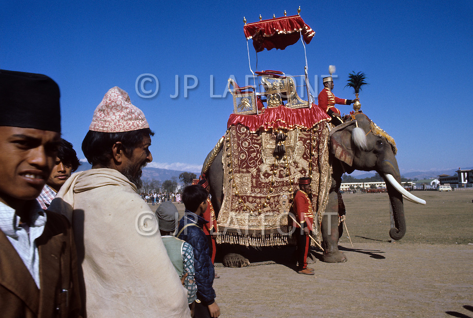 February 24th, 1975. Kathmandu. Nepal. The Coronation of King Birendra and Queen Aishwarya of Nepal, on the chosen day. At 8:37 a.m., the precise moment selected by court astrologers more than a year before, the royal priest placed the huge jewel-encrusted crown on the King's head and a diamond tiara atop Queen Aishwarya's. They were both massacred by their son Dipendra  on 1 June 2001. Photo of the Royal King elephant, getting ready for the celebration.