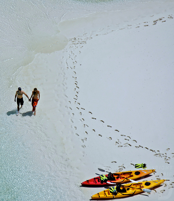 COUPLE HAVING THEIR VACATION ON THE FAMOUS THREE COCONUT ISLAND IN THE ROCK ISLANDS OF PALAU, MICRONESIA