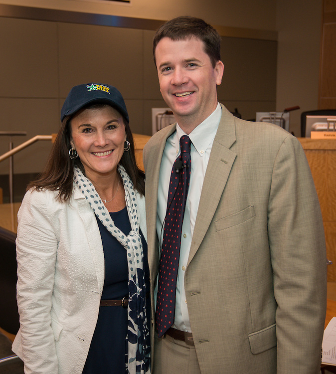Dr. Andrew Houlihan, right, recognizes Pin Oak Middle School principal Susan Monaghan, left, during a principal meeting, April 9, 2014.