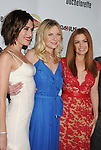 HOLLYWOOD, CA - AUGUST 23: Lizzy Caplan, Kirsten Dunst and Isla Fisher arrive at the Los Angeles premiere of 'Bachelorette' at the Arclight Hollywood on August 23, 2012 in Hollywood, California.