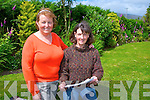 Nancy Powell left shows off her garden to Maire Ní Chathain Tralee during the Castlemaine Open Gardens on Sunday
