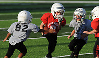 NWA Democrat-Gazette/ANDY SHUPE<br /> Friday, Aug. 11, 2017, during the 64th annual Kiwanis Kids Day Football program at Wildcat Stadium at Har-Ber High School in Springdale. Visit nwadg.com/photos to see more photographs from the games.