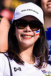 A Thailand soccer fan has the Thai national flag painted on her face to show supports to the team during the AFC Asian Cup UAE 2019 Group A match between Bahrain (BHR) and Thailand (THA) at Al Maktoum Stadium on 10 January 2019 in Dubai, United Arab Emirates. Photo by Marcio Rodrigo Machado / Power Sport Images