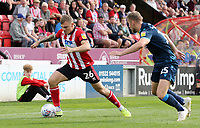 Lincoln City's Harry Anderson under pressure from Bristol Rovers' Alfie Kilgour<br /> <br /> Photographer Rich Linley/CameraSport<br /> <br /> The EFL Sky Bet League One - Lincoln City v Bristol Rovers - Saturday September 14th 2019 - Sincil Bank - Lincoln<br /> <br /> World Copyright © 2019 CameraSport. All rights reserved. 43 Linden Ave. Countesthorpe. Leicester. England. LE8 5PG - Tel: +44 (0) 116 277 4147 - admin@camerasport.com - www.camerasport.com
