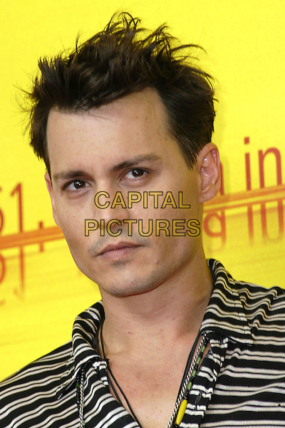"JOHNNY DEPP.""Finding Neverland"" Photocall.61st Venice Film Festival, Italy, .September 4th 2004..portrait headshot striped top.Ref: KP.www.capitalpictures.com.sales@capitalpictures.com.©Capital Pictures."